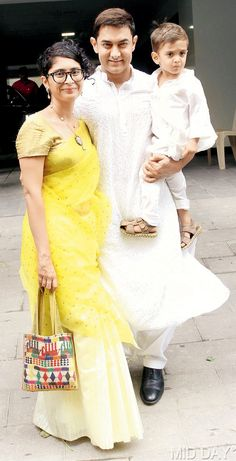Aamir Khan, along with wife, Kiran Rao and son, Azad, struck a 'happy family' pose outside his Carter Road residence as he greeted his fans on the occasion of Eid. Pic/Satyajit Desai : In pictures: Top Bollywood stars celebrate Eid Bollywood Couples, Bollywood Stars, Bollywood Fashion, Indian Celebrities, Bollywood Celebrities, Bollywood Actress, Celebrity Couples, Celebrity Weddings, Kiran Rao