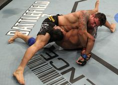 Mir's Kimura on Minotauro. The most brutal arm-breaking submission win I've seen in my entire life. UFC 140