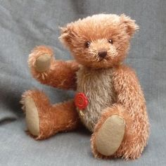 Made of sparse, reddish string mohair with a beige mohair body, this bear has amber and black safety eyes and felt paws. Love Bear, Teddy Bears, Red, Vintage, Teddybear