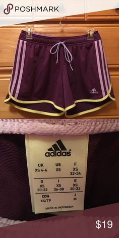 Adidas Running Shorts 💥make me an offer!💥                                             Hardly worn Adidas running shorts. Purple, light purple, and yellow on the front and the back. flaw free :-) Adidas Shorts