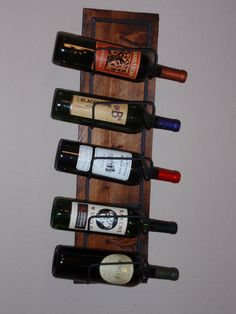 Our latest wine rack - Do you like it? Find it here https://www.etsy.com/listing/212191623/wall-wine-rack-for-5-bottles?