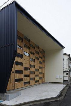 69ca03345fd Small Japanese Home Exhibiting an Intriguing Wooden Facade  Checkered House