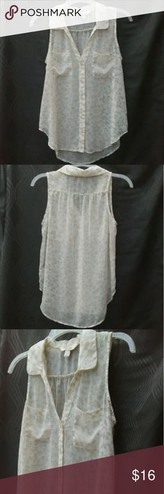 Decree Sleeveless Sheer Blouse, size S Decree Sleeveless Sheer Blouse, size S. Pre-owned in excellent, like new condition. Cute front pockets. Higher hem in front than the back. I took close up pictures to see the pretty pattern. Decree Tops Blouses