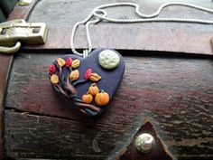 Polymer clay pendants by Nicole...