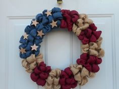 This is a handcrafted one of a kind wreath that Ive created using a 14 wire wreath form and generously looping tan, burgundy and a slate blue