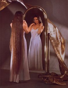 I was in awe of how long Crystal Gayle's hair was, don't know that I wanted mine that long, let it grow to my knees.