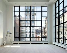 How about those ceilings and windows? See the ladder in the lower left corner....