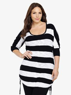With functional side cinches on the hem, this black and white striped slub knit tunic pullover takes you easily from one season to the next.