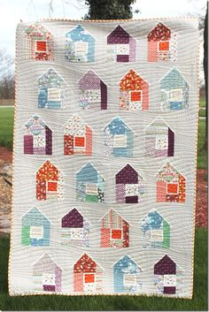 house quilt; love the quilting.  Look like pastel beach houses
