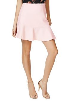 The Peplum Skirt by @justfabonline in pastel pink is a must buy. You can wear it in the winter with a pair of tights and whip it out in the spring with a pair of cute open toed wedges. #justfabapparel