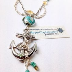 A personal favorite from my Etsy shop https://www.etsy.com/listing/200359270/nautical-anchor-necklace-citrine