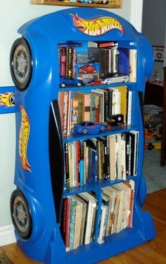 Little Tikes toddler race car bed converted into a bookshelf, with the addition of some Hot Wheels decals, taken from the Hot Wheels wall border.