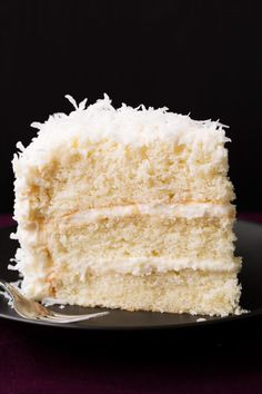 Coconut Cake - this is one of the best cakes I've ever made! So soft and tender and perfectly moist. Love the coconut cream cheese frosting too. I spread seedless raspberry preserves in the middle which was great! Warning: this cake is on the sweet side. Best Coconut Cake Recipe Ever, Coconut Recipes, Coconut Cakes, Coconut Desserts, Coconut Cake Easy, Coconut Cake Frosting, 3 Layer Coconut Cake Recipe, Rich's Coconut Cake Recipe, Old Fashioned Coconut Cake Recipe