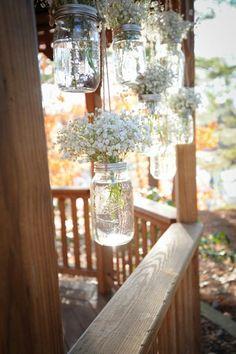 Hanging mason jars with baby's breath