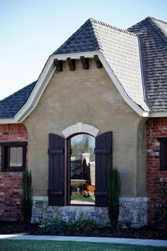 Superb Exterior Finish: Brick, Stone, Stucco With Dutch Hip Roof.
