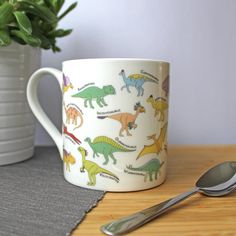 These large mugs are great for anyone who loves a giant cup of tea of coffee...and of course, dinosaurs! The mugs feature an a-z of dinosaurs drawn by me and adapted into this fun mug! The full alphabet wraps around the whole mug. Each dinosaur is labelled so you can learn while you drink  Each mug was hand decorated by me using ceramic transfers, so there may be slight differences in positioning of designs. The mugs are then fired in a kiln at 820°C.  Size: Height 91 mm x width 84 mm Hand…