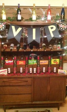 Vip hollywood party with chocolate roses party poppers theater candy and empty wine bottles with colored water diy