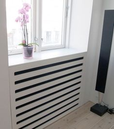 Use these radiator cover ideas to transform your room. See how to use a radiator cover for storage, reading nooks under windows, corner cabinets + more. Wall Heater Cover, Radiator Heater Covers, Radiator Screen, Modern Radiator Cover, Baseboard Heater Covers, Best Radiators, Home Radiators, Contemporary Radiators, Classic Cabinets