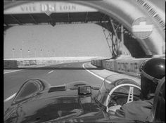 Mike Hawthorn(Lemans winner 1955) driving a preview lap on the Lemans track in a Jaguar.(1956!)