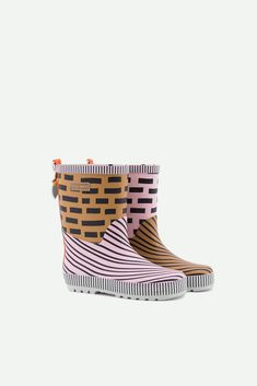 A panache gold + mendl's pink + royal orange rainboot. These rainboots are handmade and every pair is unique. available in 14 sizessize range - - natural rubber The rainboots run a bit bigger. If you're in doubt between two sizes, please size down. Kids Rain Boots, Colorful Backpacks, Sustainable Fabrics, Natural Rubber, Toddler Shoes, Heeled Mules, Pairs, Orange, Heels
