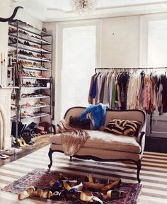 dream closet - tufting a bench out of a coffee table, DIY clothes rack from pipe, and a couple book shelves for shoes, and a rug and vanity.