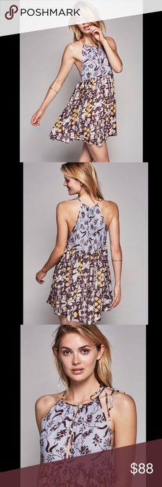 ❗️SALE❗️FREE PEOPLE printed slip dress Printed mini slip featured in a flowy silhouette with a high neck and dropped armholes. Keyhole opening at the bust with a front button closure. Adjustable tie strap on one side.662145  Retail: $78   ❤I have over 300 new with tag Free People items for sale! I love to offer bundle discounts!  ❤No trades. love the item but not the price? Submit an offer! Free People Dresses