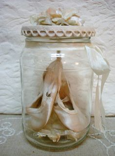 Ohhhhh, now I know what to do with my children's Indian Moccasins, Ballet shoes, babies first shoes, etc.  Thanks Dishfunctional Designs: Creative Things To Do With Old Baby Shoes