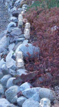 Dominion Antique Glass Insulators as sidewalk lighting