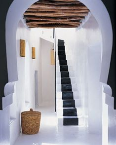 "Painted Marrakech stairwell. This falls into the literal ""in my dreams"" category. Photo by Roger Davies for Elle Decor"
