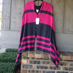 SWANCHO Converts from a poncho to a scarf ...short in the back long in the front. I also have one in blue/black. Each sold individually. Specify which color when purchasing Accessories