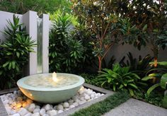 small water fountain and white pebbles