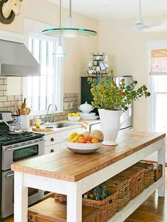 I love the long butcher block top island.  The subway tile backsplash, the large moulding aroudn the window