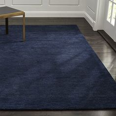 "Shop Baxter Indigo Blue Wool 8'x10' Rug.  A variegated heather effect looms a family of tonals to ground the room in fresh ""solids"" with more interest, more range, more depth and more texture.  Hand-loomed plush New Zealand wool."