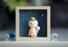 Nori and Yori . Kokeshi doll no. 7 When Yori was born, the Moon was much brighter than normal and the sky full of shiny stars. Nori carries