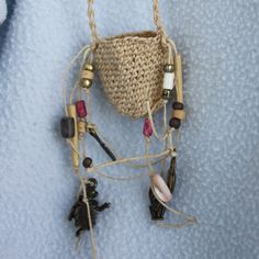 Necklace - Basket Pouch Amulet - Waxed Linen Thread - Twined - Fiber Jewelry. $32.00, via Etsy.