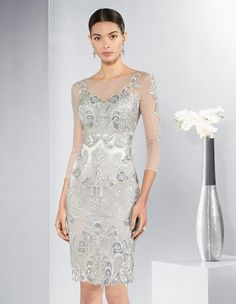 Stunning silver mother of the bride or groom outfit. Intricate lace detailing.  Also perfect for day at the races, cruise or evening dress. Scotland, UK. www.froxoffalkirk.com
