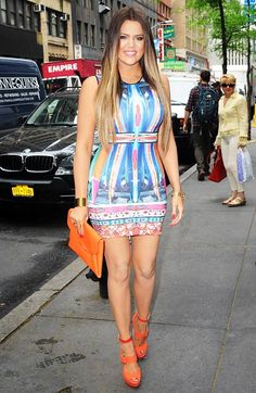 Khloe Kardashian in Colorful Figure-Hugging #Dress with Orange clutch & shoes | street style #fashion