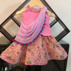 No automatic alt text available. Kids Indian Wear, Kids Ethnic Wear, Little Girl Dresses, Girls Dresses, Kids Party Wear, Kids Wear, Frock Models, Kids Lehenga, Baby Lehenga