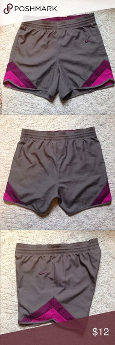 "Nike Dri-fit shorts Grey and purple XS Nike Dri-fit running shorts. Like new, one small snag on back under  the word ""dri-fit"". Nike Shorts"