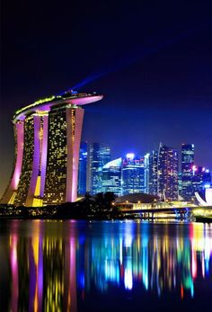 Singapore city skyline at night   10 things you Must Do while in Singapore