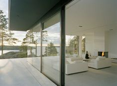 :: ARCHITECTURE :: This house on a rocky hilltop in Sweden by Swedish architectJohn Robert Nilsson sits uponon a limestone-covered concrete plinth, which provides a continuous floor surface inside and outside of the house.