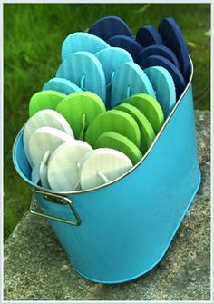 ...keep a bucket 'o sandals at the ready for anyone who forgot their own. (idea from The Enchanted Home - Coastal Chic)