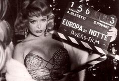 """French transgender revue and burlesque star Coccinelle (Jacqueline-Charlotte Dufresnoy) in a promotional photo for Alessandro Blasetti's """"Europa di notte"""" (English title: """"European nights"""", 1959)."""