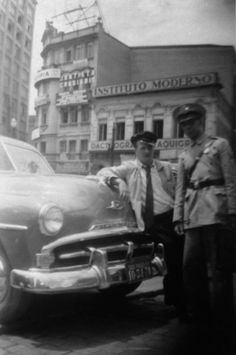 Taxi driver and police officer at Sao Joao Avenue. Sao Paulo - Brazil