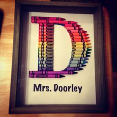 """Crayon Letter Art I made for my sister's kindergarten classroom! I used a large font """"D"""" and cut crayons using a box cutter. Then I super glued them on and put it in a shadow box. Crayon Letter, Crayon Art, Letter Art, Crayon Ideas, Teacher Appreciation Gifts, Teacher Gifts, Classroom Door Signs, Diy And Crafts, Crafts For Kids"""