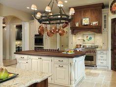 kitchen; like the island with butcher block top and matching range hood.