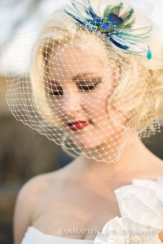 Cute vintage-classy hair, and veil! LOVE!!!almost exactly what I want to wear but not quite :)
