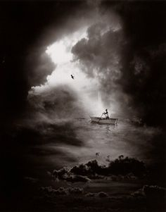 By Jerry N Uelsmann. These are not digital images. They are made the traditional old fashioned way, in the dark room