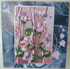 roses and ribbons on Craftsuprint designed by Debra Jenkinson - made by chell sharpe - I printed the sheet out onto 220gsm good quality photo paper. I matted the base image onto silver linen finish card, added a feather