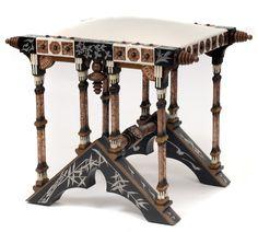 CARLO BUGATTI Sgabello Tabouret, c. 1895, 46.5cm H.     SOLD $11,280 Germany 2011 *This was inappropriately restored. The restorer added padding under the new leather making it into a stool. Originally, the parchment would have been stretched flat without padding, allowing it to be used as a stool or a table.